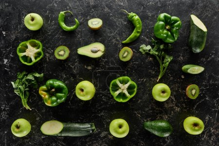 Photo for Top view of apples, avocados, cucumbers, kiwi, limes, peppers, greenery and zucchini - Royalty Free Image