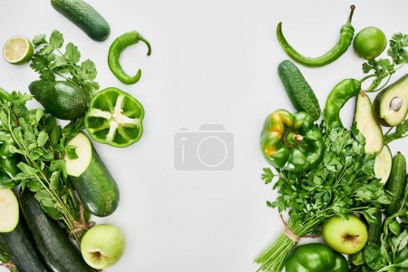 Photo for Top view of apples, avocados, cucumbers, limes, peppers, greenery and zucchini - Royalty Free Image