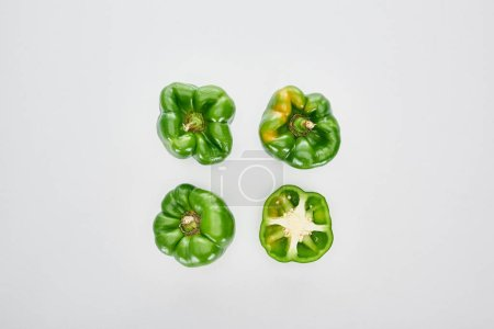 Photo for Top view of cut and whole peppers on white background - Royalty Free Image