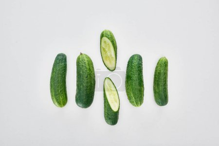 Photo for Top view of fresh and green cucumbers on white background - Royalty Free Image