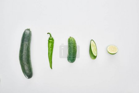 Photo for Top view of fresh and green cucumbers, lime, pepper and zucchini - Royalty Free Image