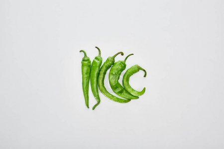 Photo for Top view of fresh and green peppers on white background - Royalty Free Image