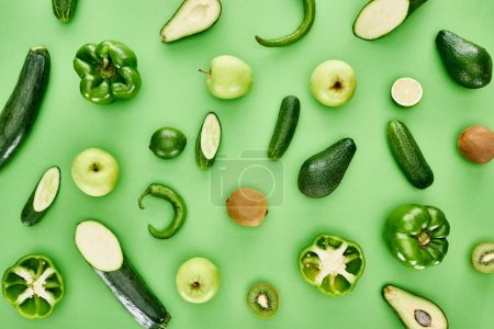 Photo for Top view of apples, avocados, cucumbers, limes, peppers, kiwi and zucchini - Royalty Free Image