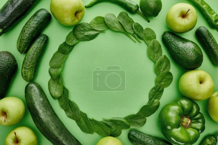 Photo for Top view of apples, avocados, cucumbers, lime, peppers, greenery and zucchini - Royalty Free Image