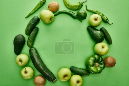 Photo for Top view of apples, avocados, cucumbers, lime, peppers, kiwi and zucchini - Royalty Free Image