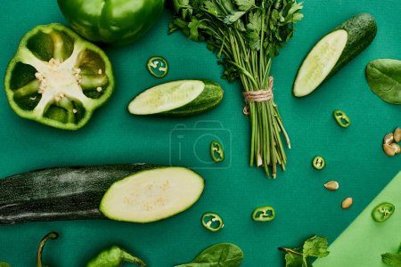 Photo for Top view of cucumbers, peppers, pumpkin seeds, greenery and zucchini - Royalty Free Image