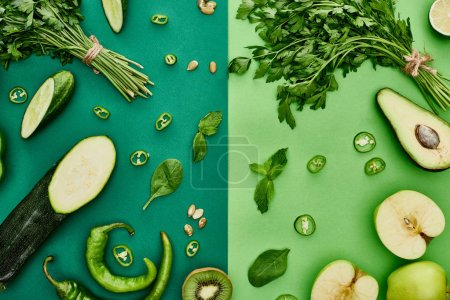 Photo for Top view of apples, avocado, cucumbers, peppers, kiwi, greenery, pumpkin seeds and zucchini - Royalty Free Image