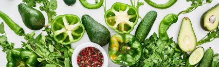 Photo for Panoramic shot of spices, peppers, greenery, cucumbers and avocados - Royalty Free Image