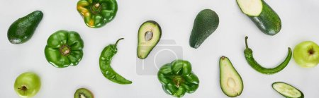Photo for Panoramic shot of peppers, cucumber, apples, zucchini and avocados - Royalty Free Image