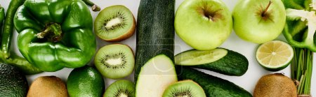 Photo for Panoramic shot of peppers, cucumbers, zucchini, kiwi, lime, apples and avocado - Royalty Free Image