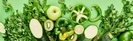 Photo for Panoramic shot of peppers, cucumber, kiwi, apples, greenery and zucchini - Royalty Free Image