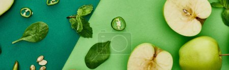 Photo for Panoramic shot of peppers, apples, pumpkin seeds on green background - Royalty Free Image