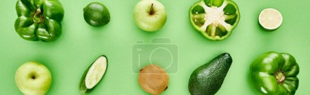 Photo for Panoramic shot of peppers, cucumber, kiwi, apples, limes and avocado - Royalty Free Image