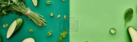 Photo for Panoramic shot of fresh and cut cucumbers, peppers and greenery - Royalty Free Image
