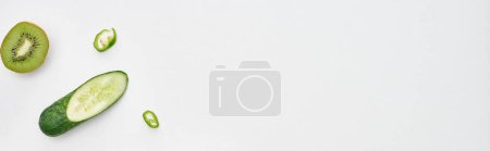 Photo for Panoramic shot of fresh cucumber, kiwi and peppers on white background - Royalty Free Image