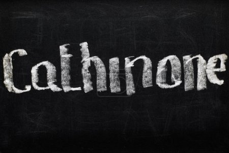 Photo for Top view of black chalk board with lettering cathinone - Royalty Free Image