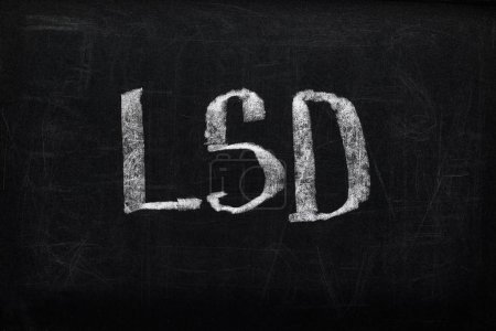 Photo for Top view of black chalk board with lettering LSD - Royalty Free Image