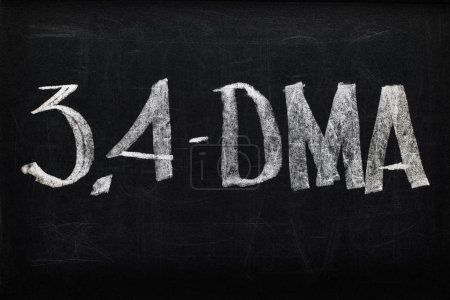 Photo for Top view of black chalk board with lettering 3.4-DMA - Royalty Free Image