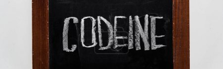 Photo for Panoramic shot of black chalk board with lettering codeine - Royalty Free Image