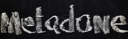 Photo for Panoramic shot of black chalk board with lettering metadone - Royalty Free Image