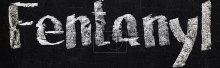 panoramic shot of black chalk board with lettering fentanyl