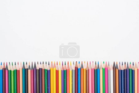 Photo for Straight line of color pencils isolated on white - Royalty Free Image