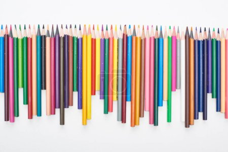 Photo for Line of different sizes color pencils isolated on white - Royalty Free Image