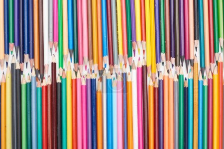 Photo for Two lines of different sizes sharpened color pencils - Royalty Free Image