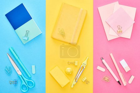 Photo for Top view of yellow and blue notepads near pink sheets of paper with different stationery on tricolor background - Royalty Free Image