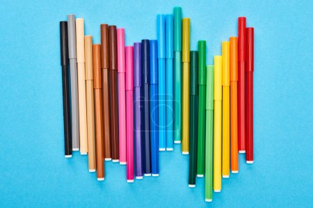 Photo for Set of bright colored felt-tip pens isolated on blue - Royalty Free Image