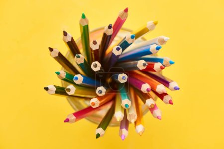 Photo for Top view of sharpened and bright color pencils isolated on yellow - Royalty Free Image