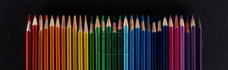 Photo for Panoramic shot of rainbow spectrum made with color pencils isolated on black - Royalty Free Image