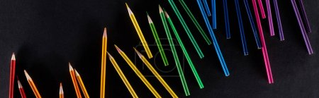 Photo for Panoramic shot of rainbow gradient made with sharpened color pencils isolated on black - Royalty Free Image