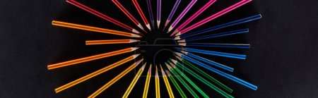 Photo for Panoramic shot of circular rainbow spectrum made with color pencils isolated on black - Royalty Free Image