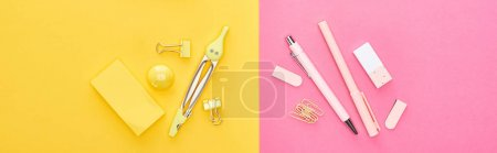 Photo for Panoramic shot of different yellow and pink stationery on bicolor background - Royalty Free Image