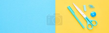 Photo for Panoramic shot of blue pen, scissors and paperclips on bicolor background - Royalty Free Image