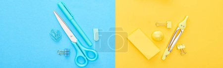 Photo for Panoramic shot of different blue and yellow stationery on bicolor background - Royalty Free Image