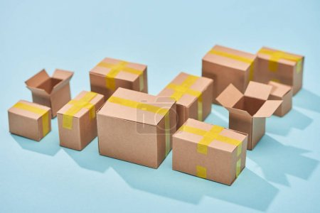 Photo for Cardboard boxes on blue background with copy space - Royalty Free Image