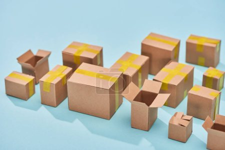 Photo for Postal cardboard boxes on blue background with copy space - Royalty Free Image