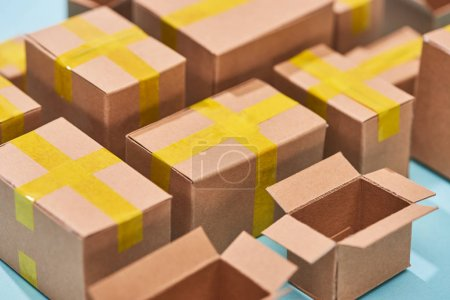 Photo for Close up view of cardboard postal boxes on blue background - Royalty Free Image