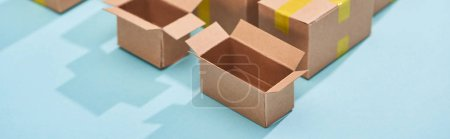 Photo for Panoramic shot of open empty postal boxes on blue background - Royalty Free Image