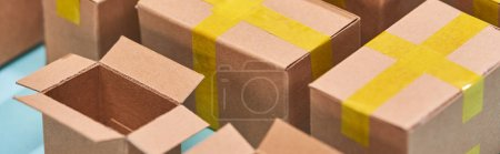 Photo for Panoramic view of miniature postal boxes with yellow adhesive tape - Royalty Free Image