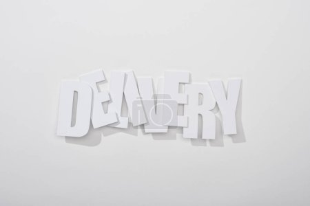 Photo for Crooked delivery inscription with shadow on white background - Royalty Free Image