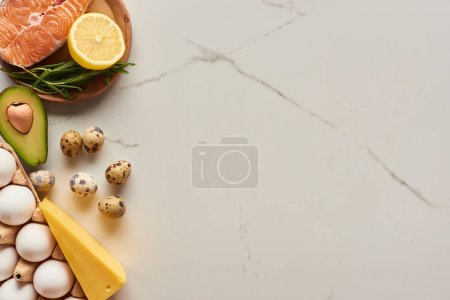 Photo for Top view of raw salmon steak with eggs, avocado, cheese and lemon - Royalty Free Image