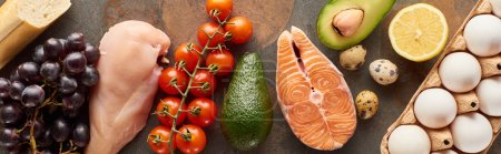 Photo for Panoramic shot of raw poultry fillet, salmon steak, vegetables, eggs, fruits and baguette on marble surface - Royalty Free Image