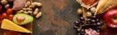 """Постер, картина, фотообои """"Панорамный снимок свежих фруктов и овощей на деревянной разделочной доске с сырой рыбой и птицей на мраморной поверхности"""""""
