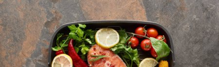 Photo for Panoramic shot of raw salmon with vegetables, lemon and herbs in grill pan - Royalty Free Image