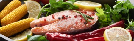 Photo for Panoramic shot of raw salmon steak with lemon, herbs and vegetables - Royalty Free Image