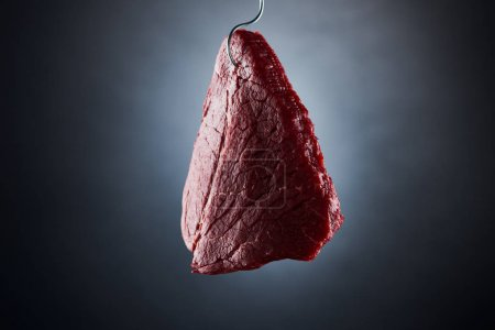 Photo for Raw beef sirloin on hook on dark black background - Royalty Free Image