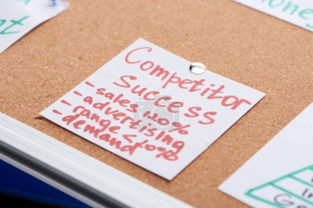 Photo for Paper card with competitor success inscription pinned on cork office board - Royalty Free Image
